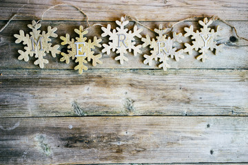 Wooden merry garland on rustic background