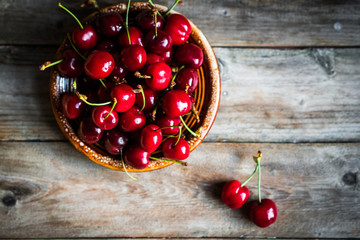 Wall Mural - Sweet cherries on rustic wooden background