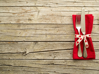 Cutlery kitchenware on old wooden boards background