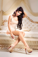 Wall Mural - Fashion portrait of young elegant woman in bed