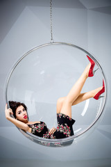 Fototapete - Sexy woman suspended from an aerial hoop