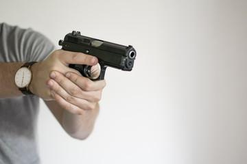 Man drawing handgun in home in self defense