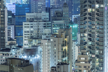 highrise residential buildings in Hong Kong city at night Fototapete