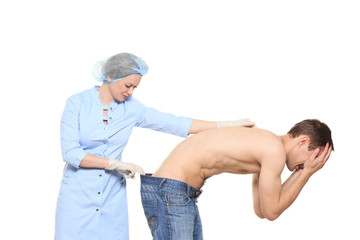 Woman doctor puts a prick. The man is afraid and feels panic. Isolated on white background