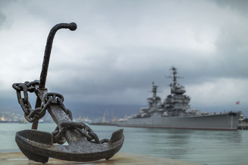 Anchor on the embankment and the cruiser in the port of Novoross