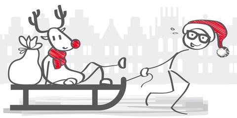 Weihnachtsmännchen zieht Schlitten mit Rentier