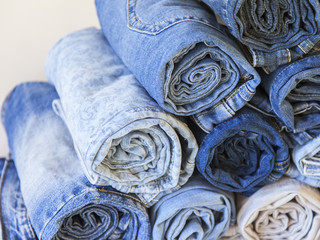 The jeans curtailed in a roll on a counter of shop