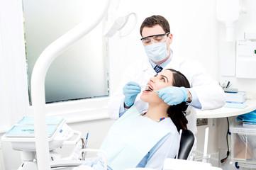 Patient getting treated by orthodontist