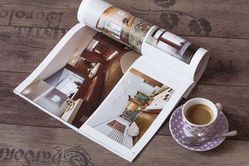 A cup of Coffee and interior magazine on the table