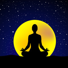 Silhouette of woman practicing yoga at night sky background