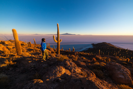 Tourist watching sunrise over Uyuni Salt Flat, Bolivia
