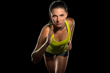 Close up of female jogger sprint runner determined athlete start of race training fitness cardio cross fit