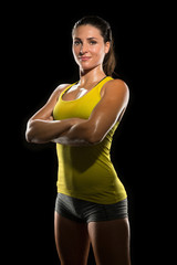 Intense determined athlete champion sweaty confident woman female powerful fighter physical trainer strong pose