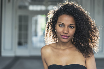 Beauty portrait of pretty young mulatto woman with beautiful mak