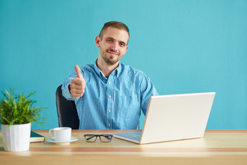 Businessman making gesture ok