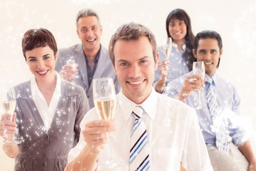 Composite image of business people toasting with champagne