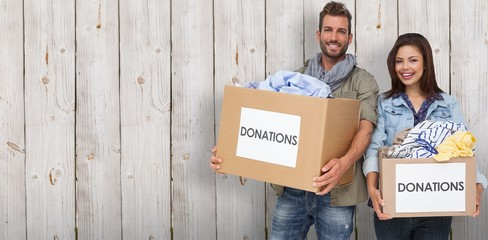 Smiling couple with clothes donation bosex