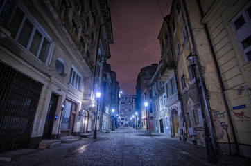 Bucharest, Romania – August 23, 2014: Night street scene in Bucharest old city.