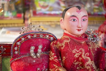 The Chinese god of Prosperity, a popular New Year symbol - chinese red doll