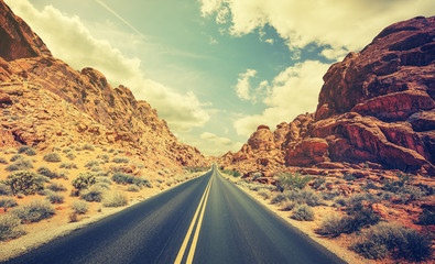 Retro stylized desert highway, travel adventure concept.