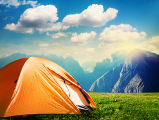 Fotobehang Kamperen tourist tent camping in mountains