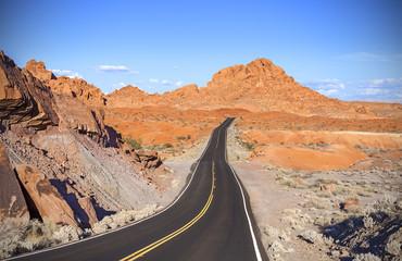 Winding desert highway, travel adventure concept.