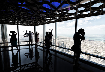 Tourists looking at Dubai cityscape from a high vantage point, U
