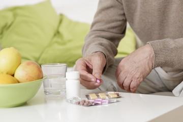 Old man taking pills