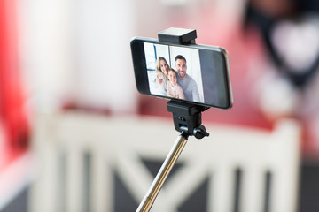 close up of happy family selfie on smartphone