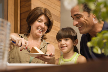 Girl and grandparents having cake