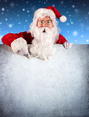 Santa Claus Pointing On A Blank Signboard