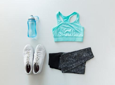 close up of female sports clothing and bottle set