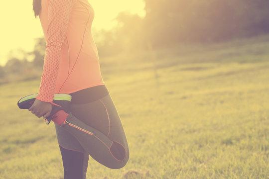 Runner woman warm up