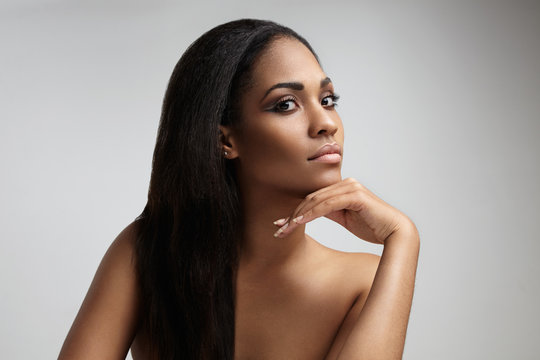 beauty black woman with a long straight hair
