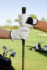 People holding golf club