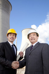 Businessmen at power plant