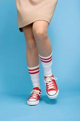 Woman wearing baseball boots