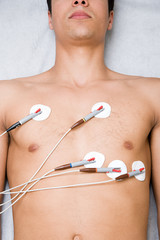 Man with electrodes on chest