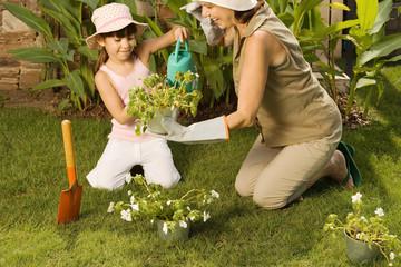 Girl and grandmother gardening