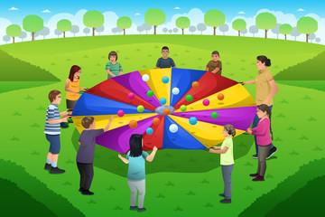 Teacher Student Playing Rainbow Parachute