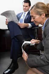 Woman polishing businessmans shoe