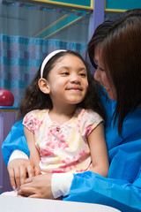 Smiling girl and nurse
