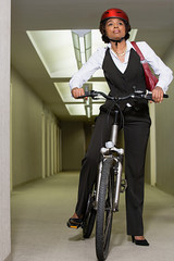Female office worker on a mountain bike