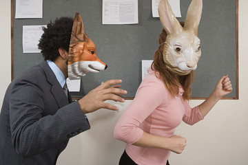 Office workers fooling around in masks