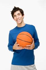 Teenage boy with a basketball