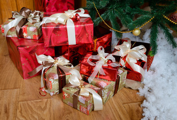 Christmas gifts under a fir-tree