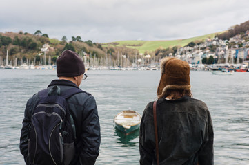 Man and woman looking at boats in village