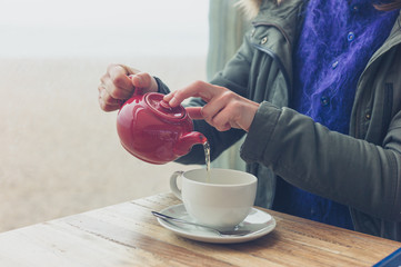 Woman drinking tea in cafe