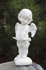 Figure of Cupid on a stone