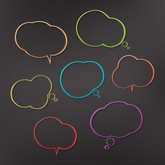 set of comic speech bubbles isolated on dark background. vector cloud icons. blank text box sign